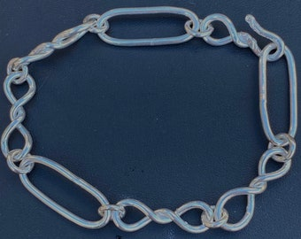 Large Trace and Twisted Link Bracelet