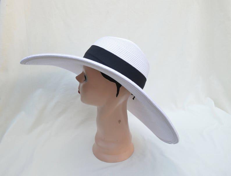 21c1c7b92a21a Large 6 Inch Flat Brim White Sun Hat With Black Ribbon Trim