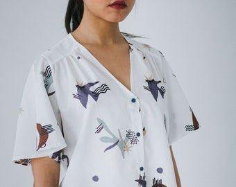 db6b27938c7f5 Striped Blouse in white cotton with abstract bird pattern