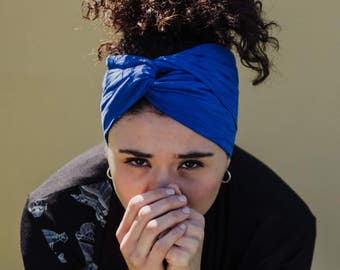 Electric blue turban headband in soft viscose jersey with a twist