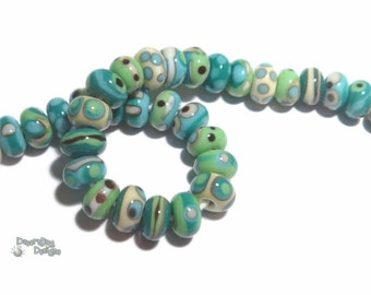 TEMPEST TUMBLERS  Handmade Lampwork Bead Set in Turquoise TEal Green Ivory Black Mix  Set of 12