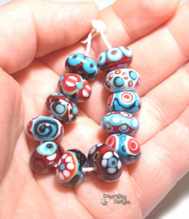 SANTA FE Handmade Lampwork Beads Red Turquoise Blue White Black Desert Bug Designs 12 Detailed Bright Beads