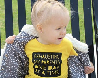 Exhausting my parents day by day. Infant, toddler and youth sizes. Toddler shirt. New parent shirt. New parent gift. Funny Toddler Clothing.