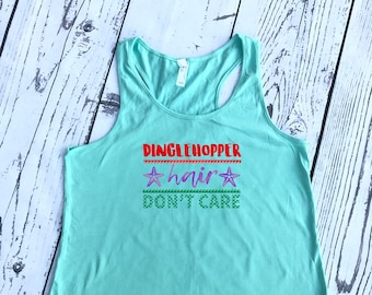 Dinglehopper hair don't care mermaid shirt. Racer Back Tank. Mermaid shirt. Mermaid Vibes. Mermaid hair, don't care. Mermaid Tank Top.