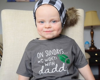 Football shirt. Infant, toddler and youth sizes. On Sundays we watch football with daddy.  Customize to your team colors!