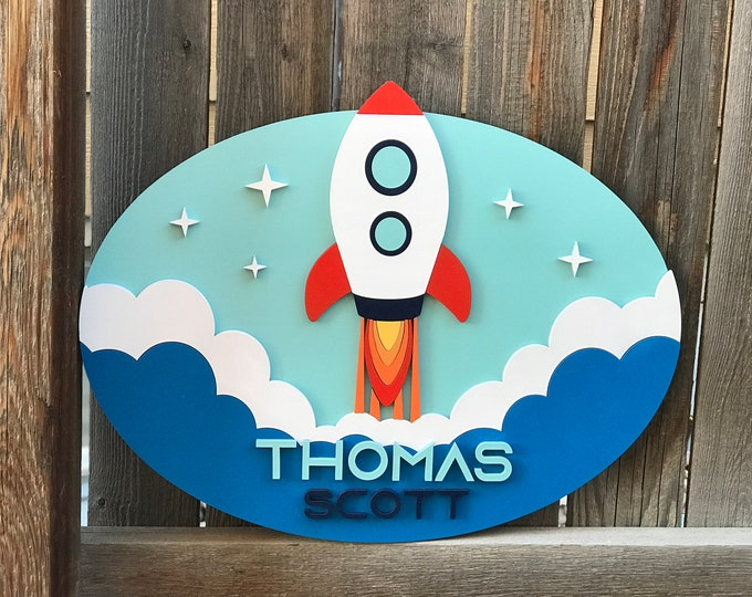 Featured listing image: Rocket Name sign | Galaxy Room | Outer Space Sign | New baby Gift | Boys Nursery Decor | Celestial nursery Decor | Oval 15 by 19 inches