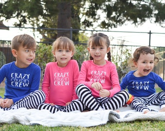 Infant, Toddler and Youth Cousin Crew Pajamas. The Original Cousin Crew Pajamas 6M - Youth 14 - Hot Pink/Black Stripe and Royal/Navy Stripe