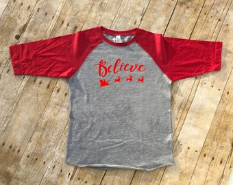 Believe shirt. Christmas 3/4 Sleeve Raglan shirt. Infant to Adult sizes. 8 color options! Believe in Santa. Fast Shipping!