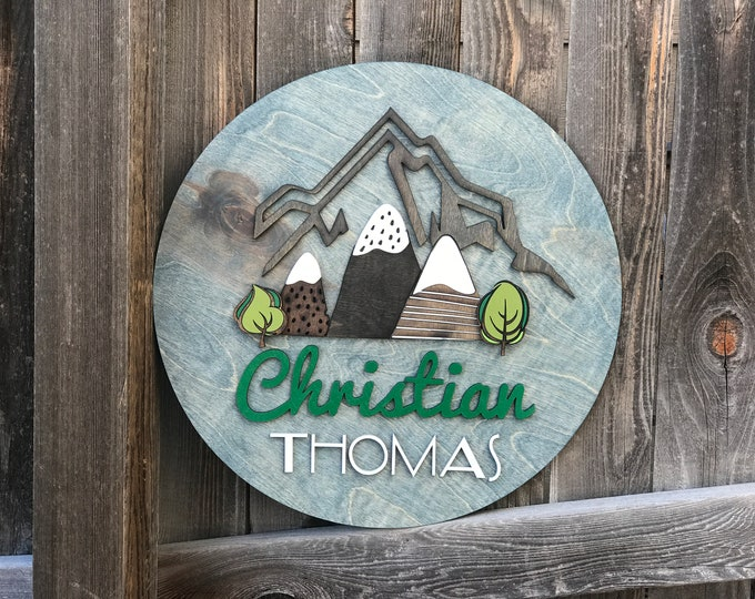 Featured listing image: Modern Mountain Name sign | Nursery Decor | Baby Wall Decor | New baby Gift | Modern Mountain Nursery 18 20 or 22 inch round sign