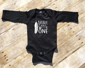 Brave little one. Brave one-piece. Long sleeve one-piece. Arrow one-piece. Brave one one-piece. Feather one-piece. Brave Shirt.