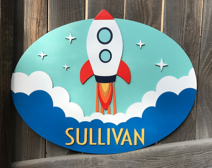 Featured listing image: Rocket Name sign   Galaxy Room   Outer Space Sign   New baby Gift   Boys Nursery Decor   Celestial nursery Decor   Oval 15 by 19 inches