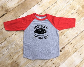 Donut Grow Up shirt. Donut Worry shirt. Donut worry be happy. Donut worry. 3/4 Sleeve Raglan shirt. Infant, Toddler & Youth NB-XL
