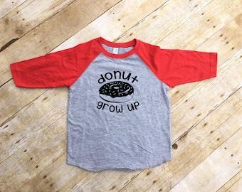 Donut Grow Up shirt. Donut Worry shirt. Donut worry be happy. Donut worry. 3/4 Sleeve Raglan shirt. Infant, Toddler & Youth NB-XL