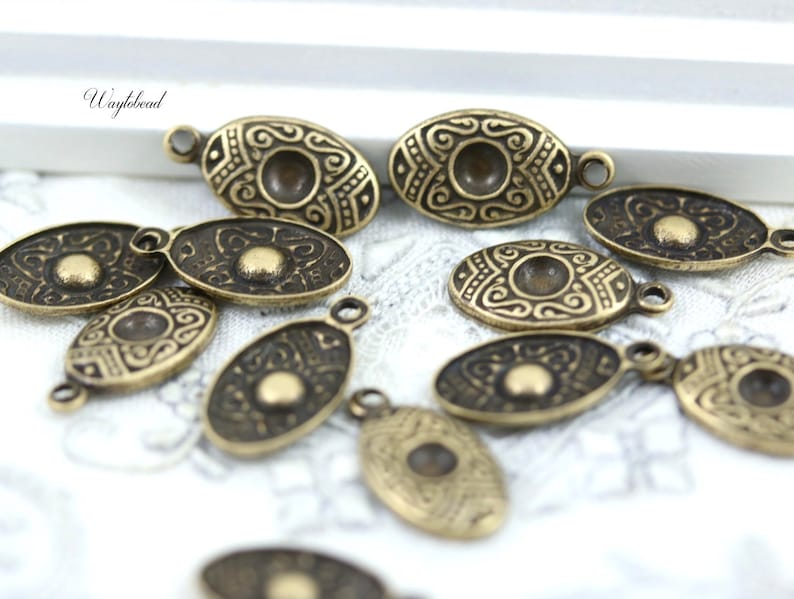 8 Antique Brass Textured Oval 8x15mm Charms Dangles