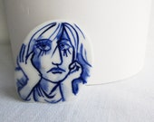 Stef - Portrait of a worried girl - Hand painted porcelain brooch in blue and white Delft - Dutch
