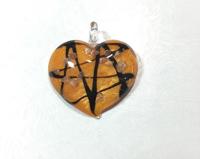 Large orange and black glass heart pendant