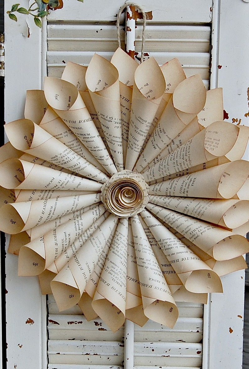 Book Page Wreath with vintage French book pages and 25 Beautifully Handmade Decor Finds for Home to help you feather your nest and also inspire your interior design schemes.