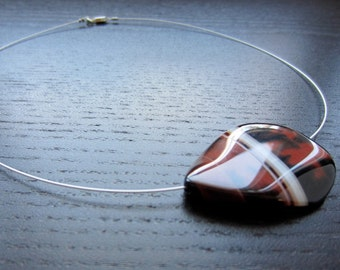 Banded agate in rust, cream and black