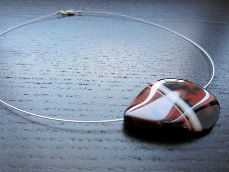 Banded agate in rust cream and black image 0