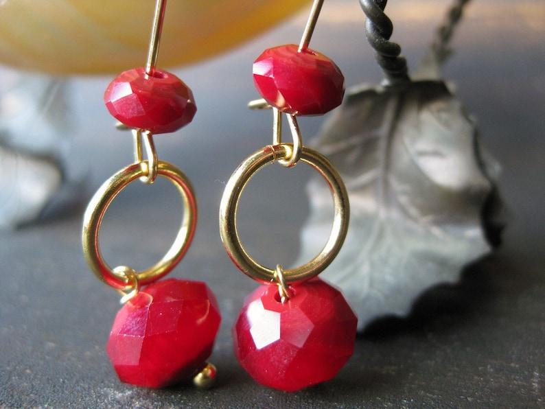 Garnet-colored glass dangle earrings image 0