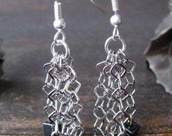 Hematite and diamond-shaped chain earrings