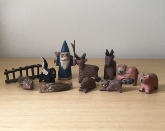 hand carved woodland gnome with animals