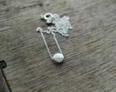 Dainty Silver Pebble Fern necklace