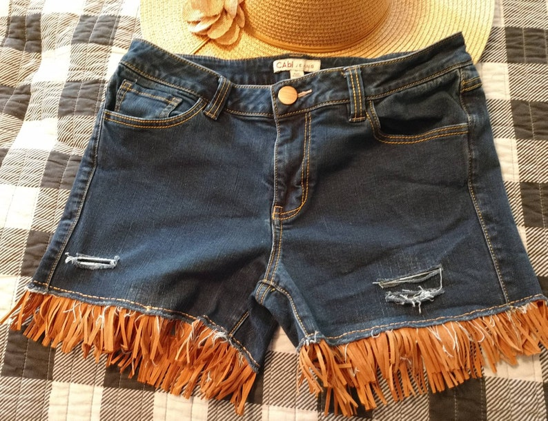 Distressed cutoff jeans sz 8 faux rawhide fringe upcycled Cabi