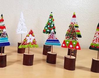 Whimsical fused glass Christmas trees on natural wood bases