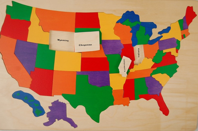 Wooden map Puzzle of the USA  has States and Capitals. Chunky image 0