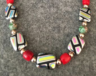 Bead neck with treated square glass beads with iridescent finish, coral beads and rose gold details, hand strung and designed, one of a kind