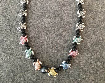 Beautiful turtle beaded necklace made by hand, one of a kind design, turtle jewelry, lucky necklace, metal turtle beads, black bead necklace