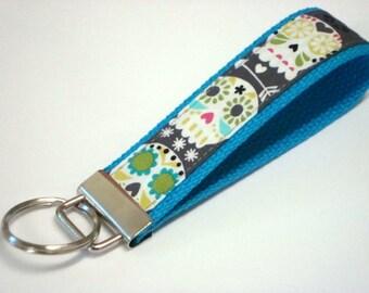 Wristlet Key Fob / Key Chain - Bonehead Sugar Skull onTurquoise Cotton Webbing