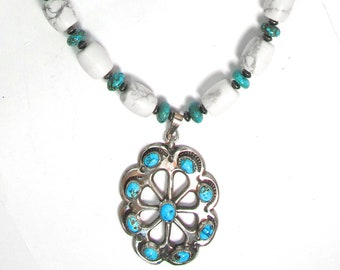 Substantial necklace in sterling silver with large sandcast sterling silver and turquoise concho and white buffalo beads