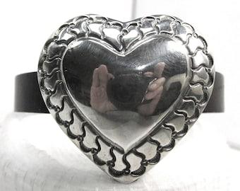 "Sterling silver vintage heart concho on Spanish leather bracelet, 6 3/4"" long."