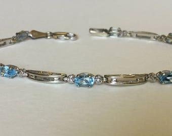 Blue topaz and diamond tennis bracelet 10k gold
