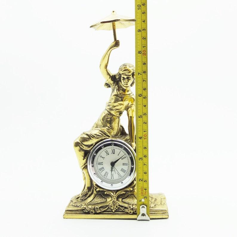Horloge de table en laiton et bois vintage