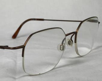 82cc9d279c Partially Rimless Modified Octogon Silhouette Eyeglasses in a Copper Bronze  Metal