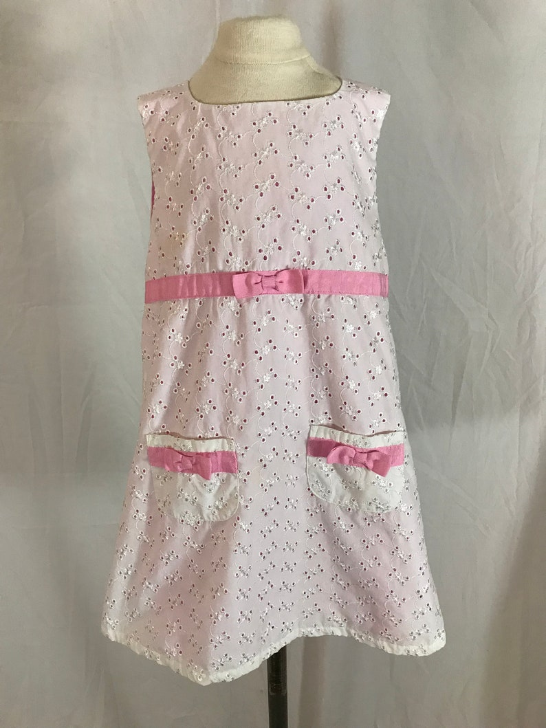 Sizs 4T Baby Togs Toddler Girl\u2019s A Line Dress White Eyelet Lined in Pink with Grosgrain Ribbon Trim and Patch Pockets