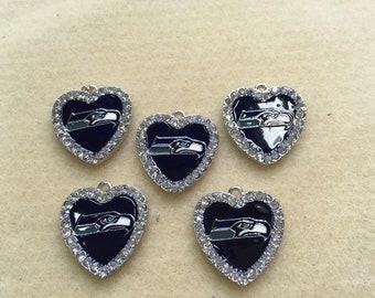 Heart shaped seahawk pendant
