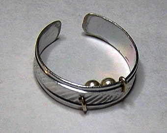 """A """"Silent Sleeper"""" Snore Relief Ring"""