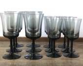 Vintage set of 12 Fostoria Princess Gray glasses | grey glass with black stem and base | 6 water goblets and 6 wine glasses