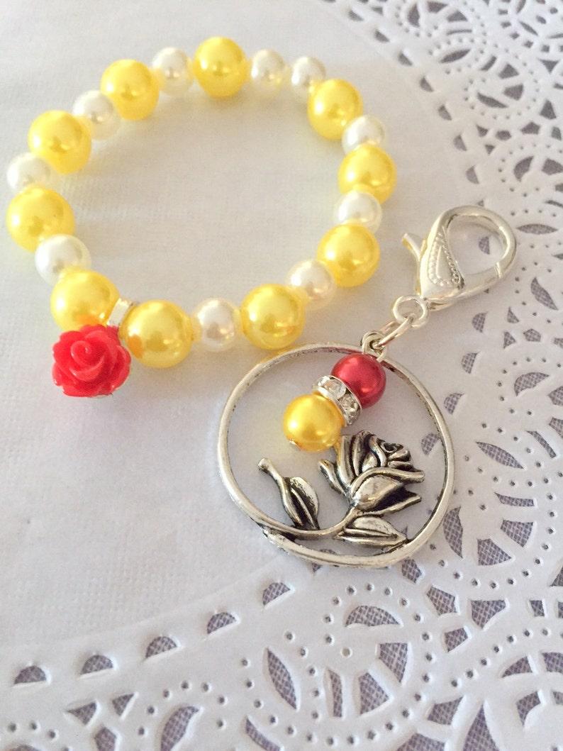 Red rose bracelet matching red rose keychain set. image 0