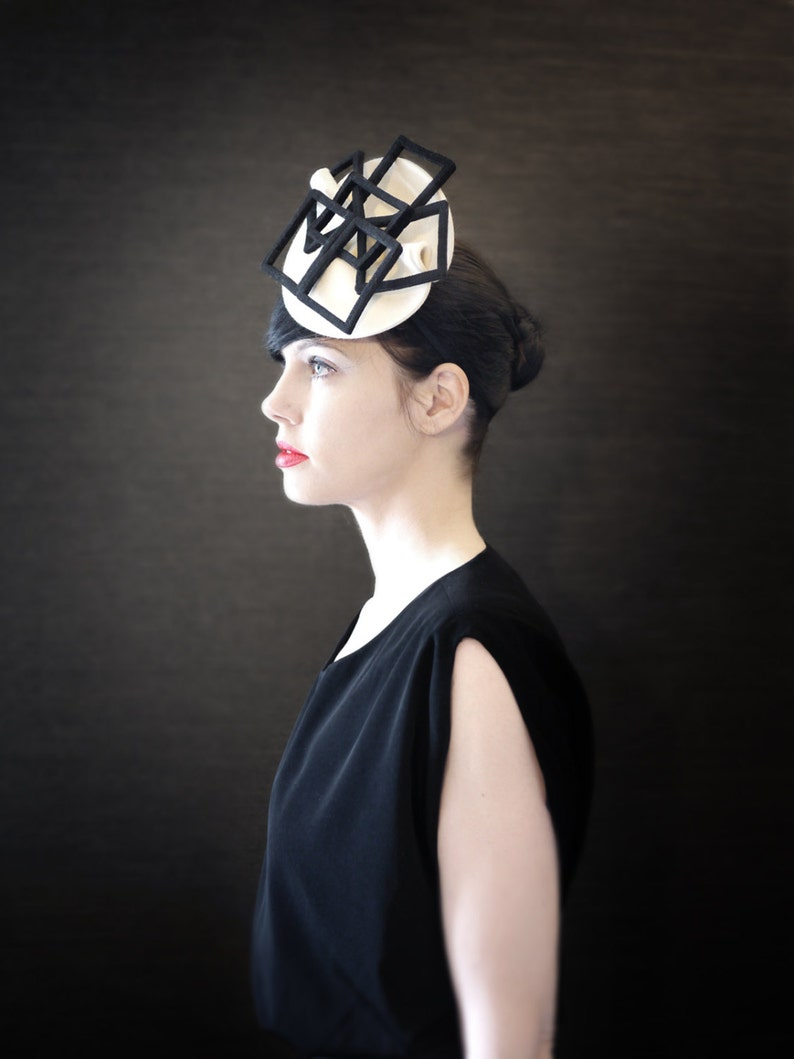 Cream Felt Fascinator Hat with Black Geometric Fan Accent  65b85fecdbd