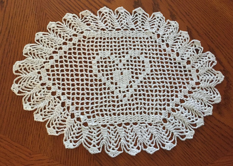 Handmade crocheted heart within a heart doily in white thread image 0