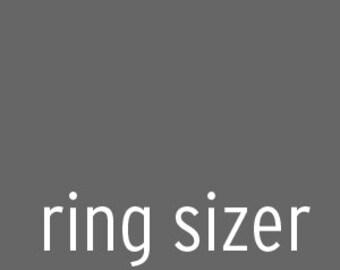 ring sizer. measuring tool.