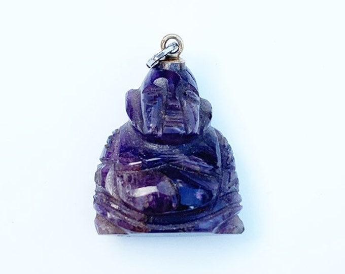 Carved Amethyst Buddha Charm