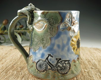 Handmade Pottery Daisy Mug with Bicycle, Porcelain Coffee or Tea Cup made with Daisies, Butterfly, Dragonfly, Cat and a Frog, Hand Built