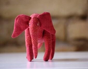 The red  linen elephant. Soft sculpture