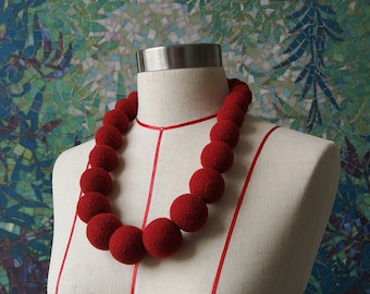 Red collar necklaces. Sustainable and eco friendly jewellery. Extravagant and stylish needle felted big beads necklaces. Made in UK. Onstail